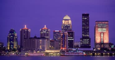 01 May 1996 --- The skyline of Louisville at night, on the Ohio River, with the riverboats  and , docked for Derby Fesitival. --- Image by © Kevin R. Morris/CORBIS